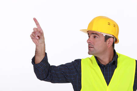 Site worker pointing photo