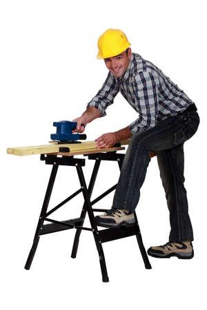 sander: Carpenter using electric sander