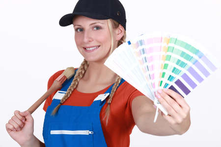 refurbishing: craftswoman painter holding a color chart