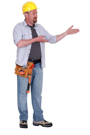 Builder gesturing Stock Photo - 13560938