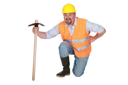 Man with pick-axe photo