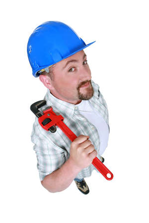 Fat plumber holding tool Stock Photo - 13561184