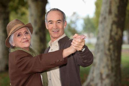senior couple on a romantic walk photo