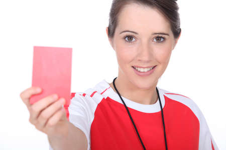 female soccer referee holding out red card photo