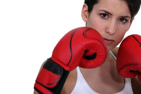 Woman wearing boxing gloves Stock Photo - 13561189