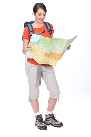 17 19 years: Woman looking at map Stock Photo