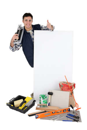 Tile cutter stood with advertising panel Stock Photo - 13584065