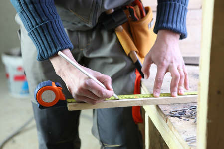 tradesmen: Joiner marking off plank of wood