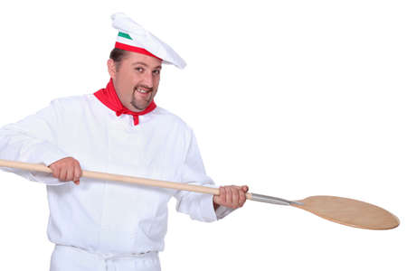 pizza chef holding a pizza loading peal photo