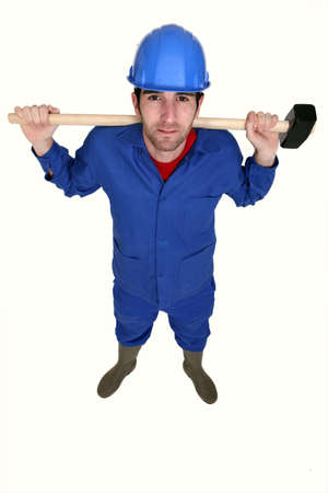 Tradesman holding a mallet photo