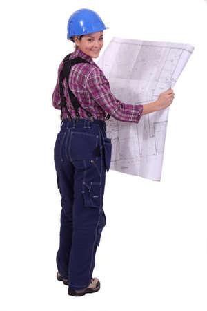jobsite: female construction worker watching a blueprint Stock Photo