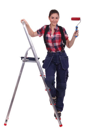 Decorator with red paint and a roller Stock Photo - 13584074