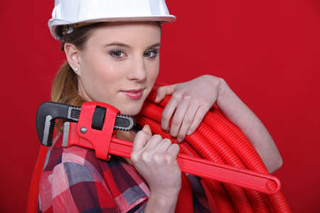 Female plumber equipped to fix problem photo
