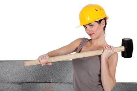 stonemasonry: Tradeswoman holding a mallet Stock Photo