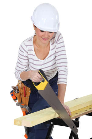 Woman using a handsaw Stock Photo - 13583807