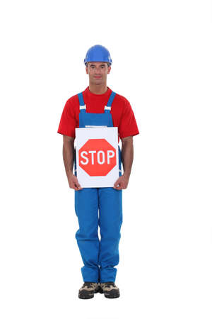 dissuade: Man holding stop sign