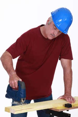 Carpenter using a saw Stock Photo - 13582882
