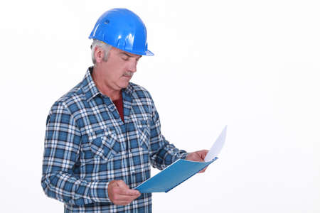 Engineer reading a report Stock Photo - 13582653
