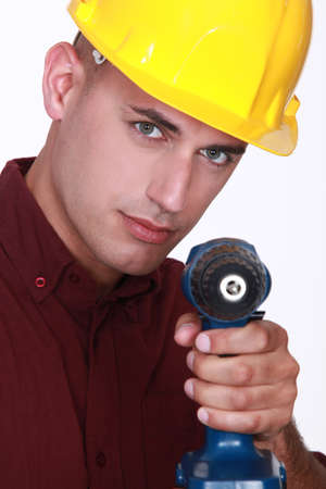 Man with an electric screwdriver Stock Photo - 13583059