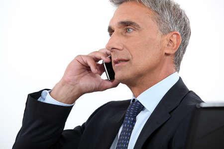chairman: Chairman on phone Stock Photo