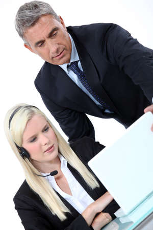 Boss looking at a laptop with an employee Stock Photo - 13582998