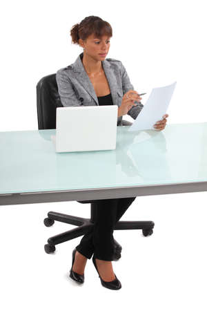 Secretary reviewing paperwork photo