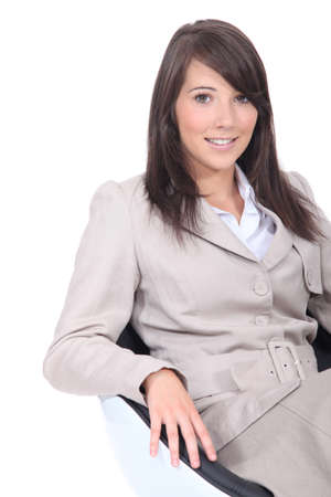 25 to 30: Businesswoman sitting in a chair Stock Photo