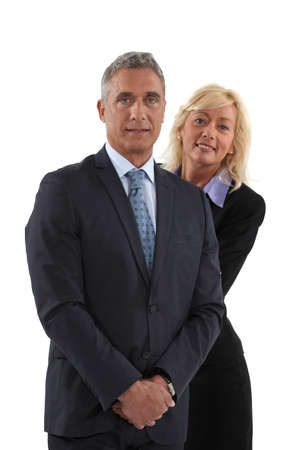 Blonde woman behind  man in a suit photo