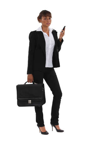 Businesswoman with briefcase and mobile Stock Photo - 13581904