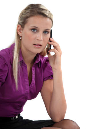 poker faced: Business professional talking on her mobile phone Stock Photo