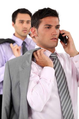Businessmen talking on their mobile phones photo