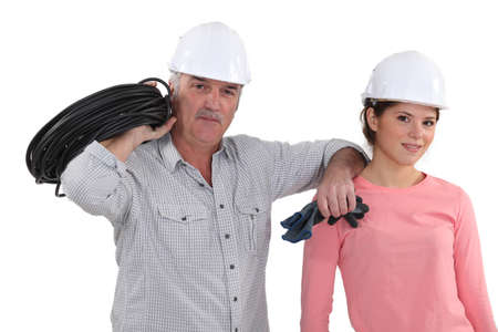 Electrician with a young female assistant photo