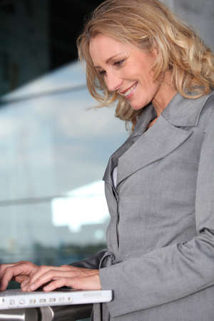 Businesswoman on laptop Stock Photo - 13582309