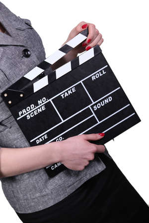 Woman holding clapboard on white background photo