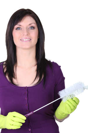 Woman in rubber gloves and a bottle brush photo