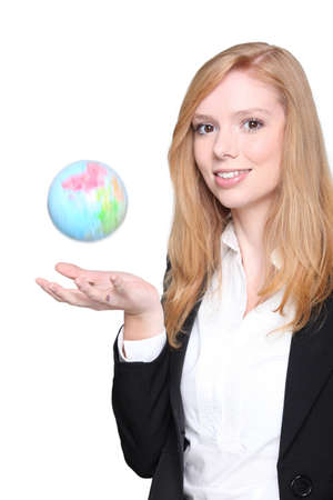 Woman throwing a mini globe in the air photo