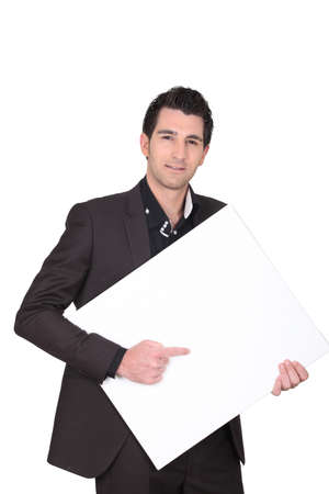 emotionless: Man pointing to a blank sign Stock Photo