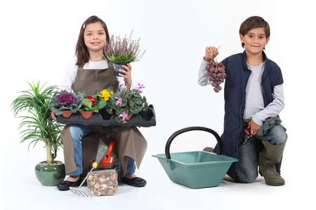 wine grower: little girl dressed in florist and a little boy dressed in grape harvester