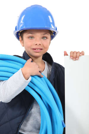 Little girl dressed as electrician Stock Photo - 13582864