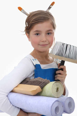 Little girl pretending to be decorator Stock Photo - 13582895
