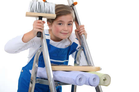 little girl on a ladder holding a brush and wallpapers photo