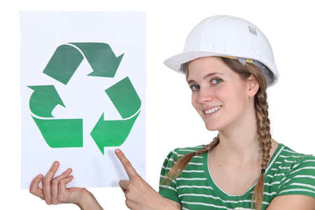 heating engineers: craftswoman all smiles showing recycling sign