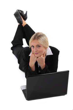 Businesswoman surfing the net photo
