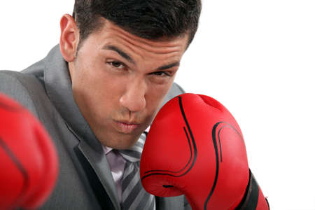Businessman throwing punches Stock Photo - 13583018