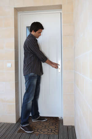 Man opening door Stock Photo - 13582307