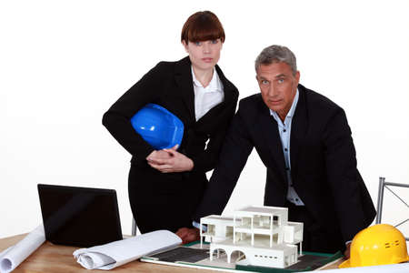 Architect and colleagues preparing business proposal Stock Photo - 13583458
