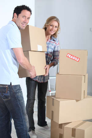 Couple stacking boxes Stock Photo - 13582645