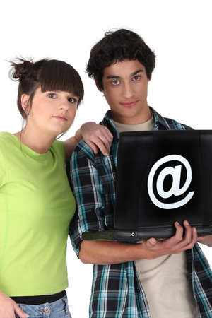 arobase: Teenagers surfing the internet Stock Photo