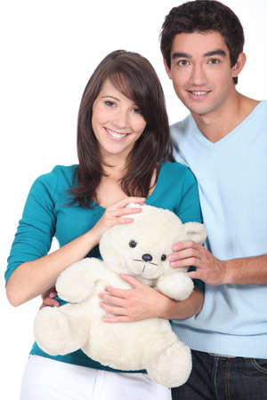 soppy: Young couple with a teddy bear Stock Photo