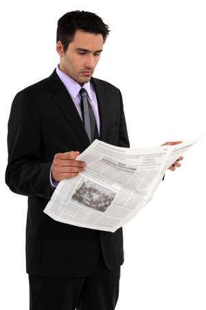 Businessman reading the newspaper photo